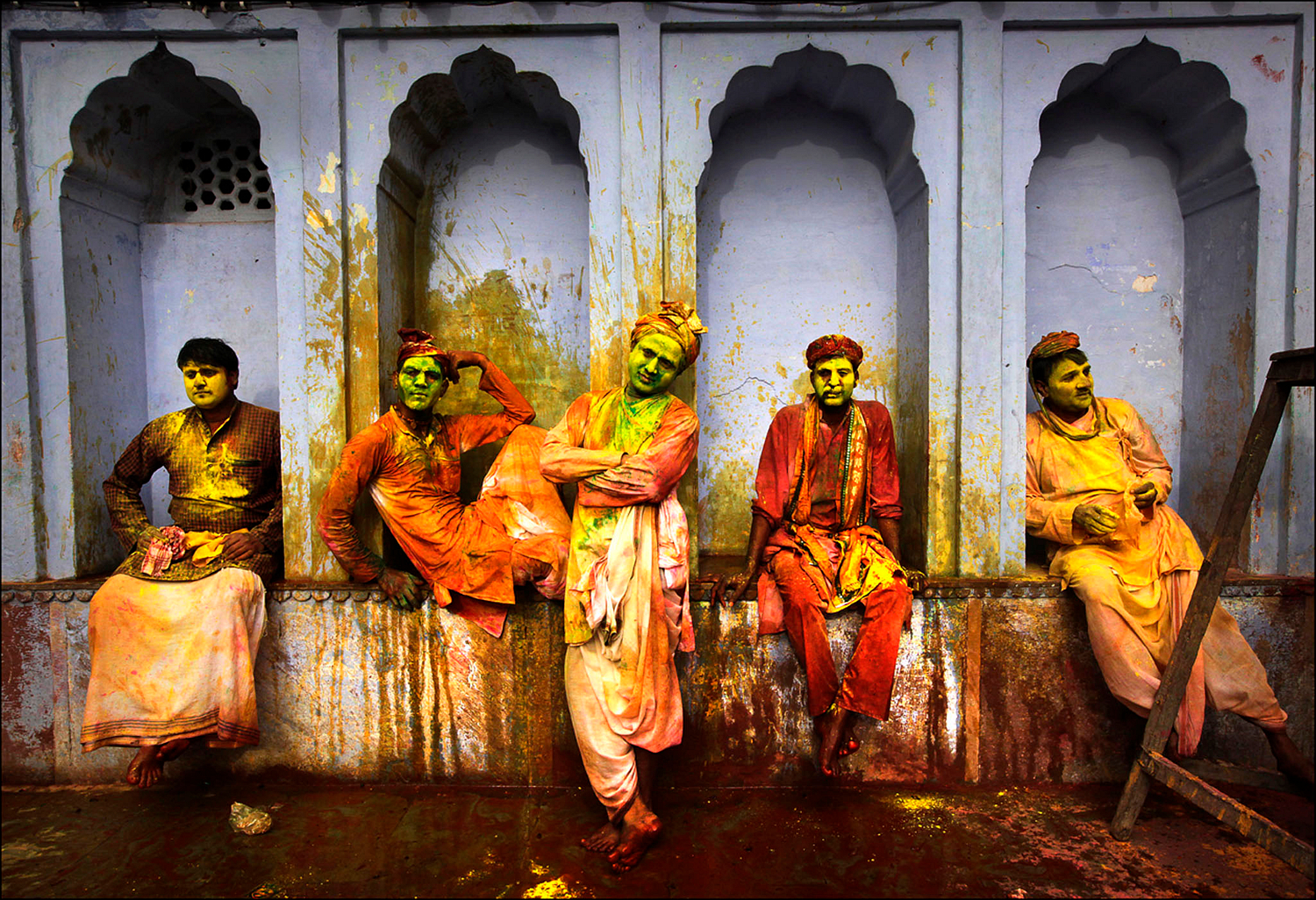 Indian villagers from Nandgaon wait for the arrival of villagers from Barsana to play Lathmar Holi at the Nandagram temple famous for Lord Krishna and his brother Balram, in Nandgaon 120 kilometers ( 75 miles)  from New Delhi, India , Friday, March 22, 2013. During Lathmar Holi the women of Nandgaon, the hometown of Krishna, beat the men from Barsana , the legendary hometown of Radha, consort of Hindu God Krishna , with wooden sticks in response to their teasing as they depart the town. (AP Photo / Manish Swarup)