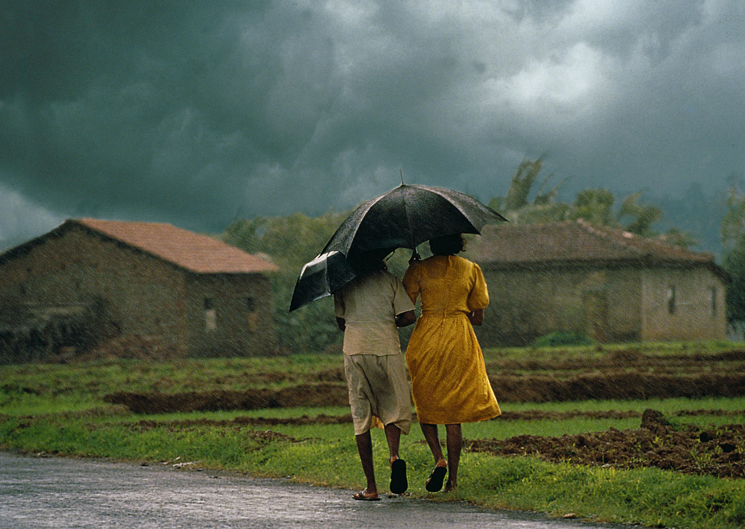 Girls walking in the rain, Goa