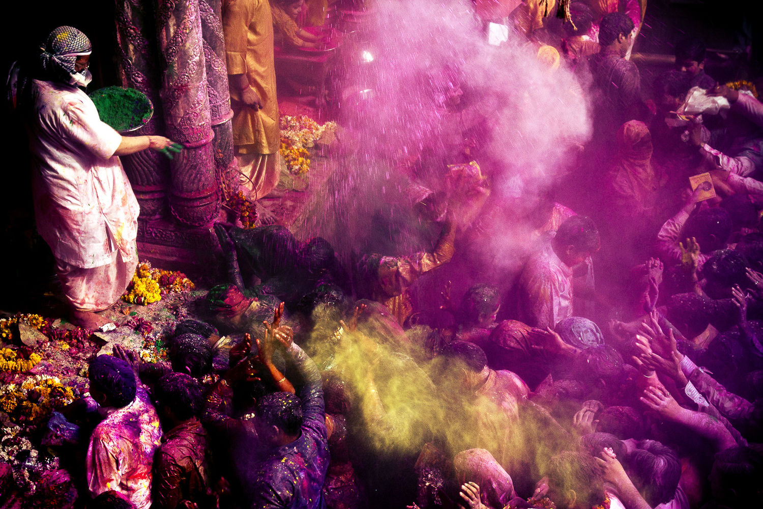 Indian pilgrims celebrate colours on the occasion of holi, festival of colours in Vrindavan, in Mathura District, Uttar Pradesh India.