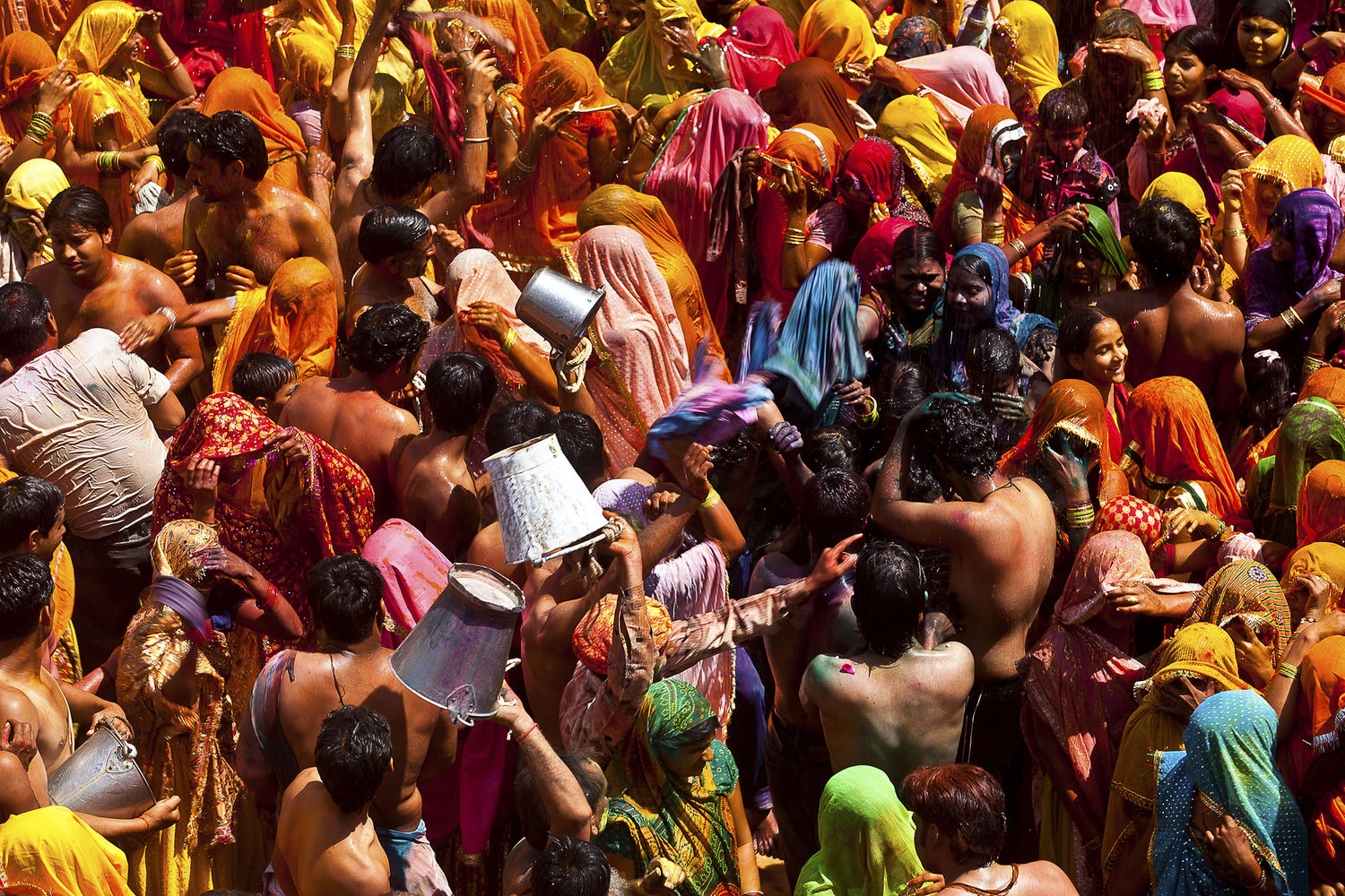 Indian pilgrims celebrate colours on the occasion of holi, festival of colours in Dauji village, in Mathura District, Uttar Pradesh India.