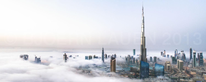 Burj Khalifa and Downtown Dubai Panorama in early morning fog