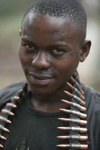 A Congolese soldier pose with an ammunition belt drapped around his neck, Thursday, Oct. 23, 2008 at their camp in Rutshuru some 75 kilometers north of Goma in eastern Congo.