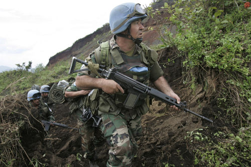 Uruguayan United Nations soldiers deploy to an observation post near the village of Kibati some 12 kilometers north of Goma in eastern Congo, Wednesday, Oct. 29, 2008.