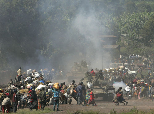 Congolese tanks and tousands of displaced people stream into Goma in eastern Congo, Wednesday, Oct. 29, 2008.