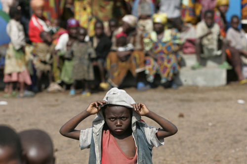 Children iwait for food aid at a camp for displacd people, Sunday , Sept. 2, 2008 in Kibati just north of Goma in eastern Congo.