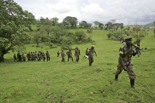 Soldiers from rebel leader Laurent Nkunda's movment return to their barracks after they showeed of their training during a mock attack at their base in Tebero,, Thursday, Nov. 6, 2008 north of Goma in eastern Congo