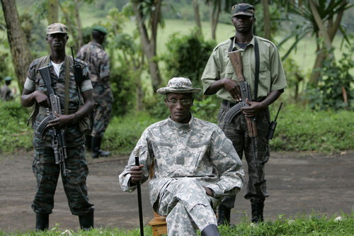 Rebel leader Laurent Nkunda is surrounded by soldiers at his base in Tebero,, Thursday, Nov. 6, 2008 north of Goma in eastern Congo