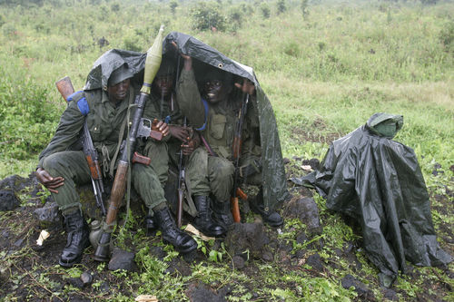 Congolese goverment soldiers take shelter from the rain on the front line, Wednesday, Nov. 12, 2008 near Kibati just north of Goma in eastern Congo.
