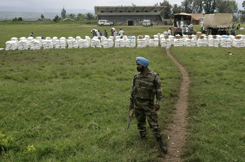 Indian UN soldiers keep guard as the World Food Program distribute food aid in the town of Rutshuru, 70 kms north of Goma, eastern Congo, Friday, Nov. 14, 2008.