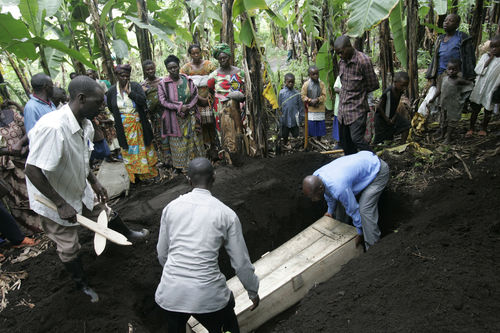 Displaced people lower the body of Rebecca Yalala, who have had died the day before of complications from diabetes and malaria ,into the earth in a grove of banana trees near a camp for displaced people, Tuesday, Nov. 18, 2008 in Bulengo near Goma in eastern Congo