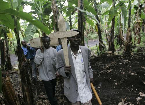 Displaced people carry the body of Rebecca Yalala,who have had died the day before of complications from diabetes and malaria as they prepare to bury her in a grove of banana trees near a camp for displaced people, Tuesday, Nov. 18, 2008 in Bulengo near Goma in eastern Congo.