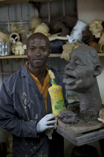 "Puppet maker Im Muchemi pose with a clay mould of a puppet at the GoDown Arts Centre , 26 February 2013 where the satirical television program, The XYZ Show is produced. A satirical television program, The XYZ Show comments on current political and social affairs in Kenya through the use of latex puppets resembling prominent figures.On The XYZ Show, national leaders in Kenya are lampooned with the purpose of using humour to address difficult and controversial national issues while promoting transparency in government.  The XYZ Show is modelled after the UK's ""Spitting Image"" and France's ""Les Guignols de L'Info"" television programs..Picture/Karel Prinsloo"