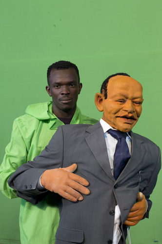 "Puppeteer Victor Otieno pose with a puppet at the GoDown Arts Centre , 26 February 2013 where the satirical television program, The XYZ Show is produced. A satirical television program, The XYZ Show comments on current political and social affairs in Kenya through the use of latex puppets resembling prominent figures.On The XYZ Show, national leaders in Kenya are lampooned with the purpose of using humour to address difficult and controversial national issues while promoting transparency in government.  The XYZ Show is modelled after the UK's ""Spitting Image"" and France's ""Les Guignols de L'Info"" television programs.Picture/Karel Prinsloo"