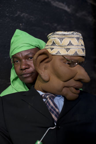"Puppeteer Fedelis Kyab pose with a puppet at the GoDown Arts Centre , 26 February 2013 where the satirical television program, The XYZ Show is produced. A satirical television program, The XYZ Show comments on current political and social affairs in Kenya through the use of latex puppets resembling prominent figures.On The XYZ Show, national leaders in Kenya are lampooned with the purpose of using humour to address difficult and controversial national issues while promoting transparency in government.  The XYZ Show is modelled after the UK's ""Spitting Image"" and France's ""Les Guignols de L'Info"" television programs.Picture/Karel Prinsloo"