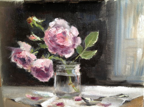 Pink roses in a jam jar