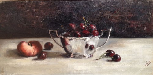 Cherries in silver bowl