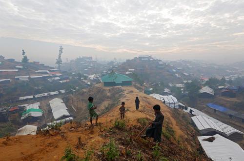 Rohingya refugee children collect firewood on top of a hill at Balukhali refugee camp near Cox's Bazar, Bangladesh