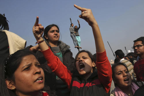 Demonstrators shout slogans near the presidential palace during a protest rally in New Delhi