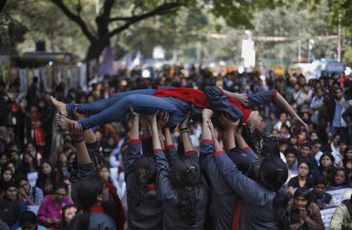 Demonstrators perform a street play on rape during a protest near India's parliament in New Delhi