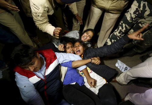 Police detain demonstrators during a protest against the release of a juvenile rape convict, in New Delhi