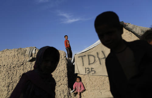 Internally displaced Afghan children play at a refugee camp in Kabul