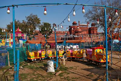 An empty swing is seen after a fair was called off after the government banned public gatherings to avoid the spreading of the coronavirus, in old quarters of Delhi