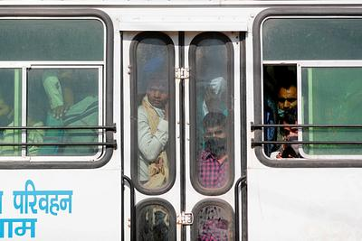 Migrant workers are seen inside a crowded bus as they return to their villages, during a 21-day nationwide lockdown to limit the spreading of coronavirus disease (COVID-19), in Ghaziabad,
