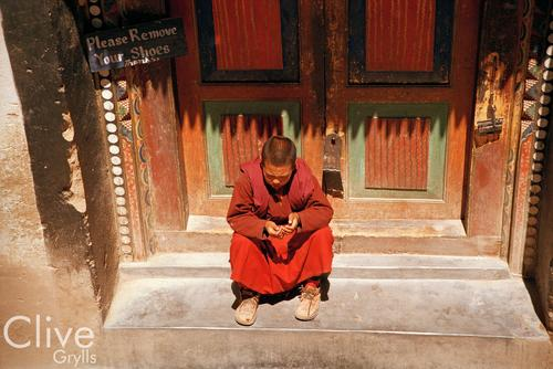 A monk sits in reflection outside a chamber of the Hemis temple, Ladakh.