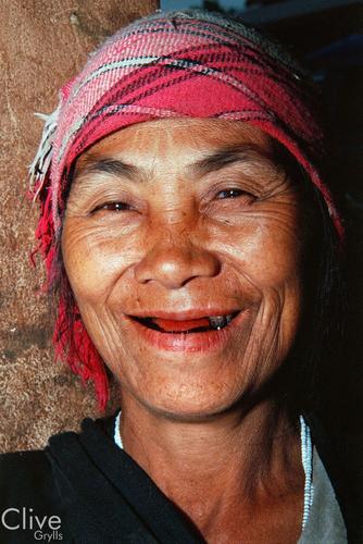 Tribal lady at the market at Muang Sing, Luang Namtha Province.