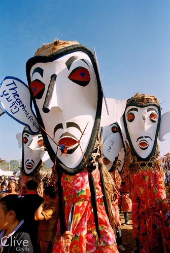 Masked dancers performing in a parade at the annual Elephant Festival held in Sayaboury Province.