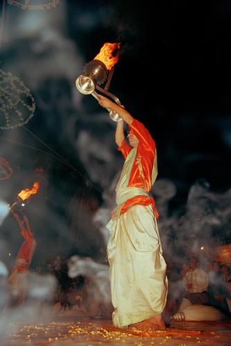 CDevotees performing at the 'Ganga Seva Midhi' festival held on the Dashashwamed ghat. Varanasi, Uttar Pradesh.live Grylls photography