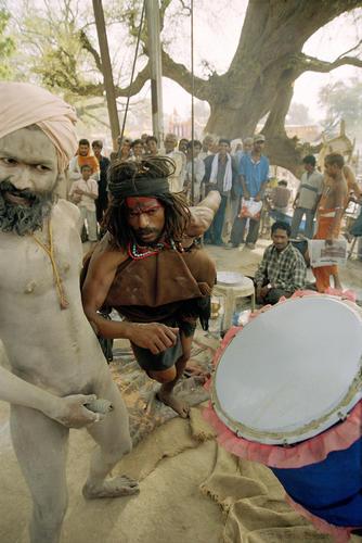 Sadhus performing a fertility ritual at the Kumbh Mela festival. Ujjain, Madhya Pradesh.