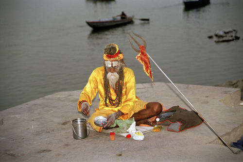 Sadhu performing a puja on a platform overlooking the Ganges, Varanasi, Uttar Pradesh.