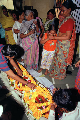 A body of a loved one lays in rest waiting for cremation at the Manikarnika Ghat in Varanasi, Uttar Pradesh.