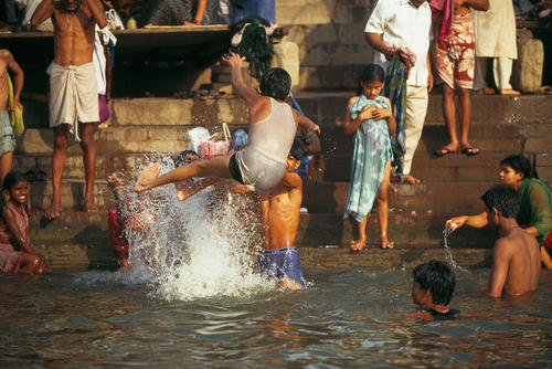 Children cooling off in the River Ganges. Varanasi, Uttar Pradesh.