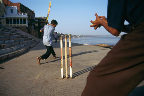 Children playing cricket on a ghat. Varanasi, Uttar Pradesh.