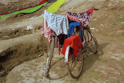 Washing drying on a bicycle on a ghat at Varanasi, Uttar Pradesh.