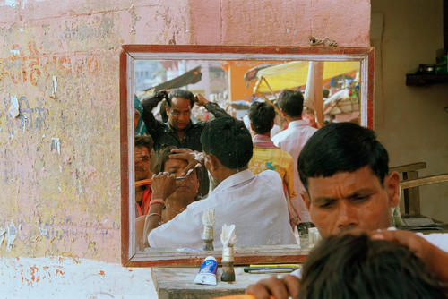 Open air barber's shop. Varanasi, Uttar Pradesh.