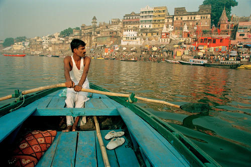 Rowing the River Ganges. Varanasi, Uttar Pradesh.
