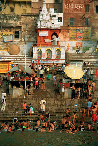 Devotees bathing in the River Ganges. Varanasi, Uttar Pradesh.