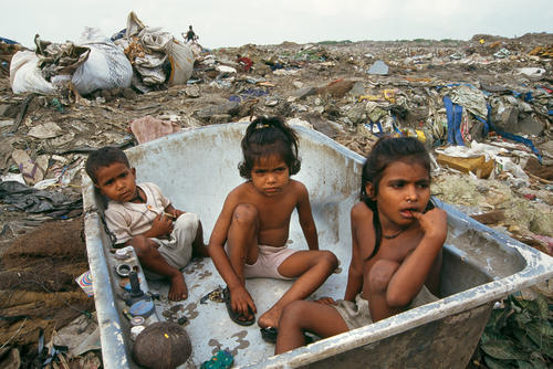 Children living in a bath at Mumbai's largest refuse site.
