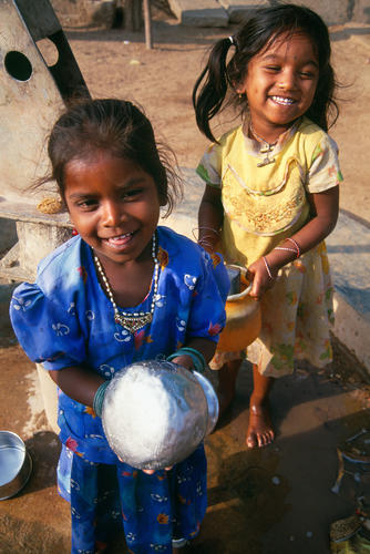 Two young girls enjoying washing up. Hampi, Karnatica.