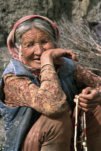 Old lady with traditional beads at Kibber in the Spiti Valley, Himachal Pradesh.