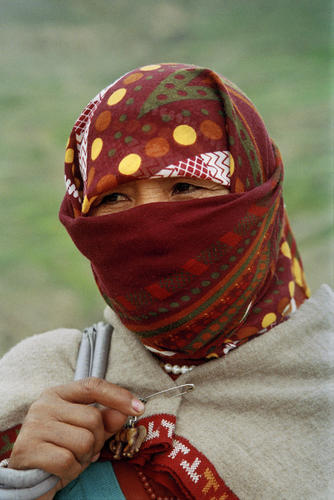 Lady wrapped against the cold at Kibber in the Spiti Valley, Himachal Pradesh.