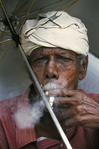 Fisherman having a smoke close to Alappuzha, Kerala.