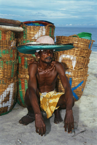 Fisherman attired in traditional hat close to Alappuzha, Kerala.