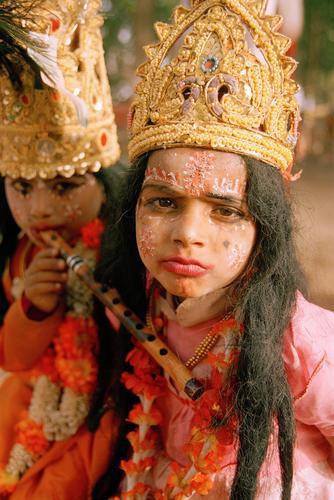 Young girls with a flute at the Kumbh Mela Festival. Ujjain, Madhya Pradesh.