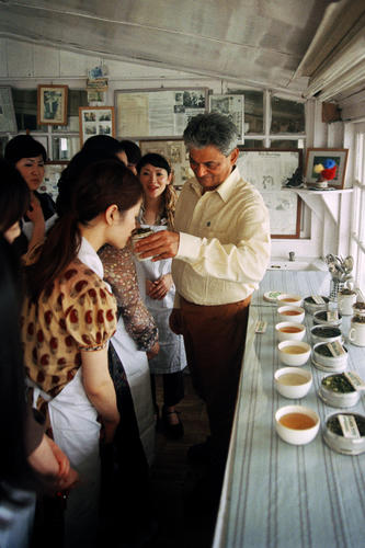 Rajah Banerjee, the owner of the Makaibari Tea Estate tasting tea with customers at his office in Kurseong, West Bengal.
