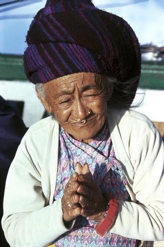 Old lady praying in Darjeeling, West Bengal.