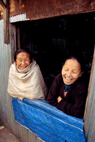 Two local women enjoying a joke in Darjeeling, West Bengal.